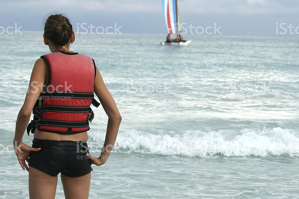 woman looking at sailboat royalty-free stock photo