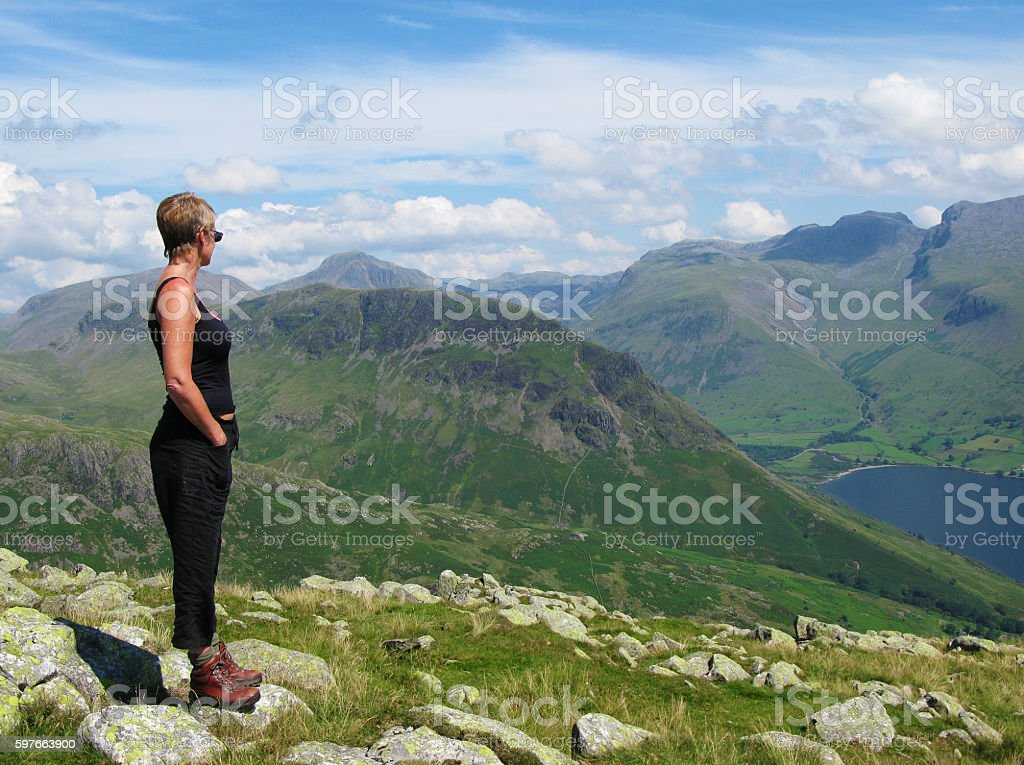 Woman Looking at Scafell over Wasdale stock photo
