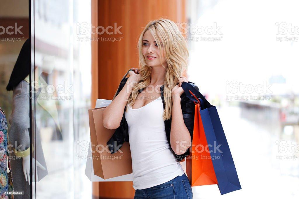 Woman looking at showcase stock photo