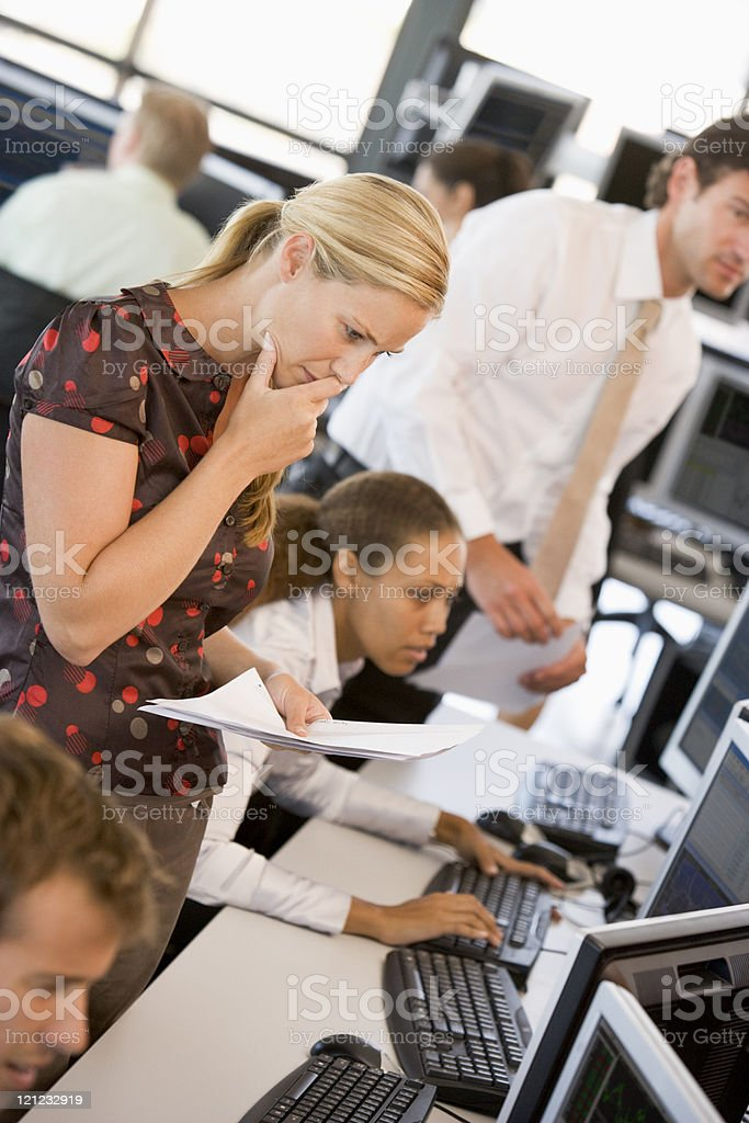 Woman Looking At Stock Reports stock photo
