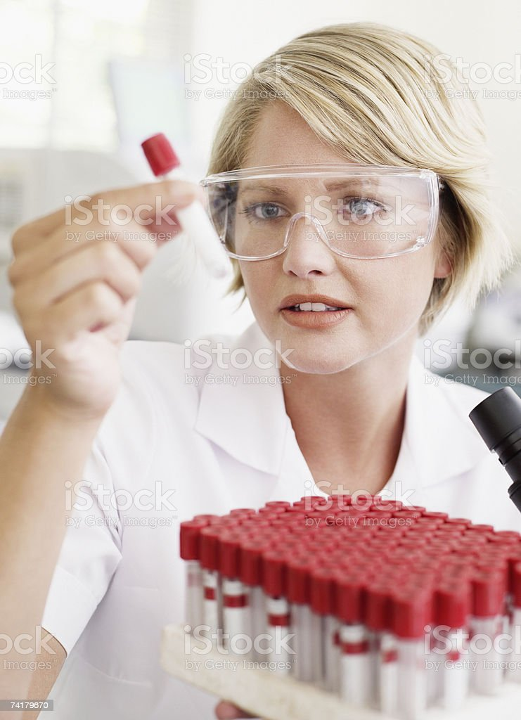 Woman looking at test tubes royalty-free stock photo