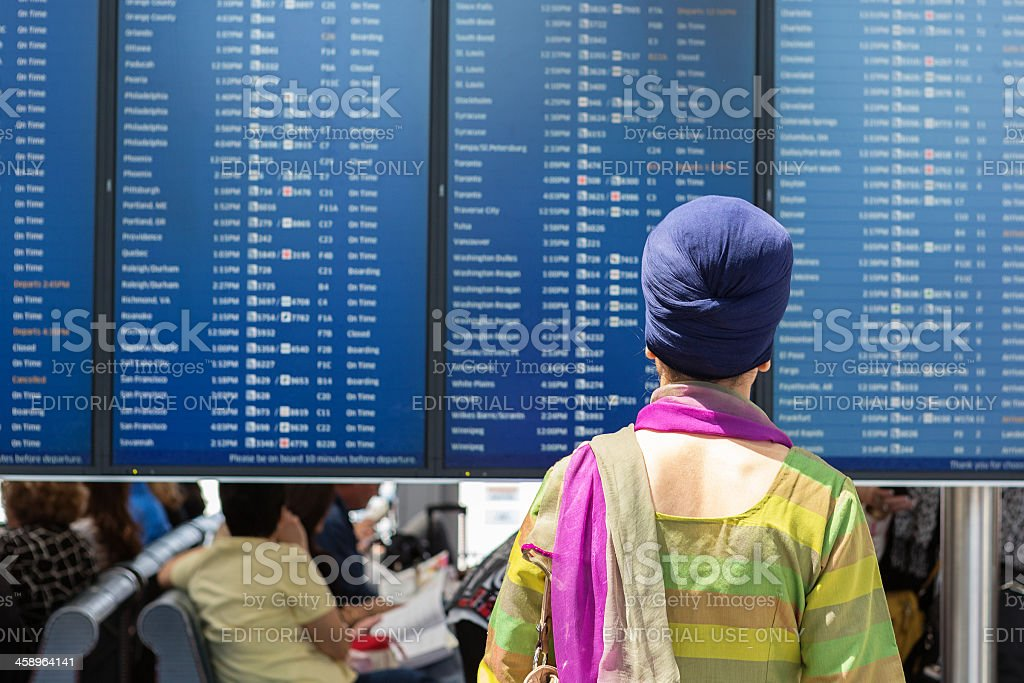 Woman looking at the information board royalty-free stock photo
