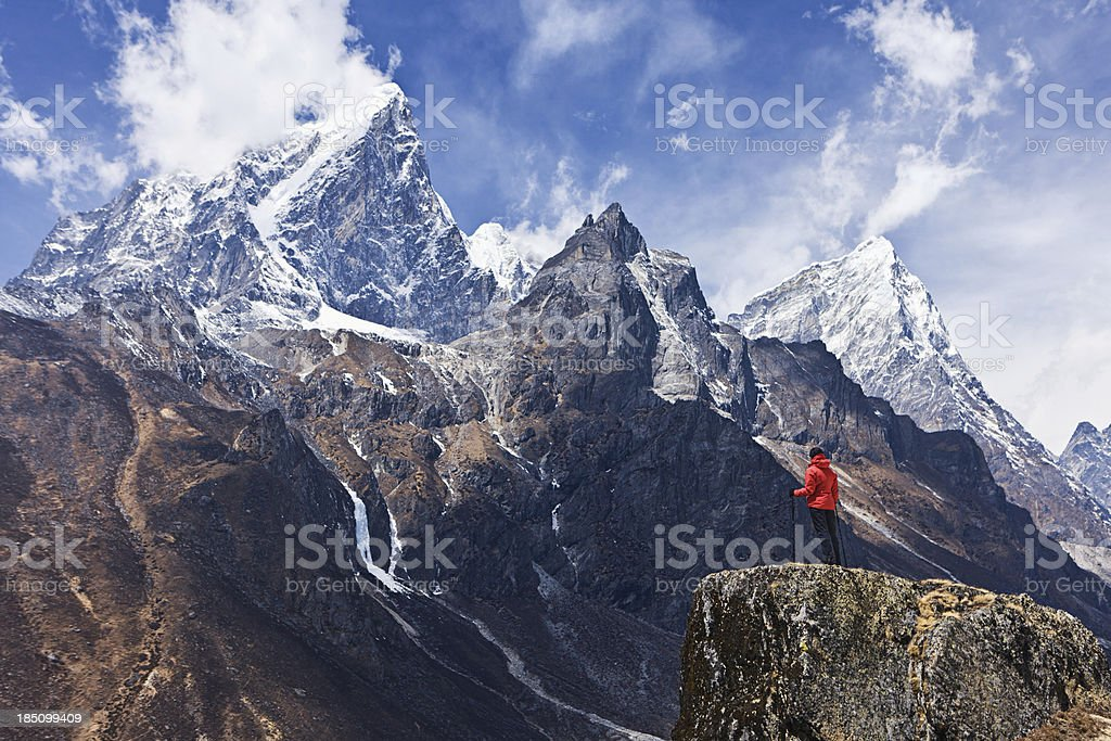 Woman looking at the mountains, Mount Everest National Park stock photo