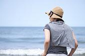 Woman looking at the sea