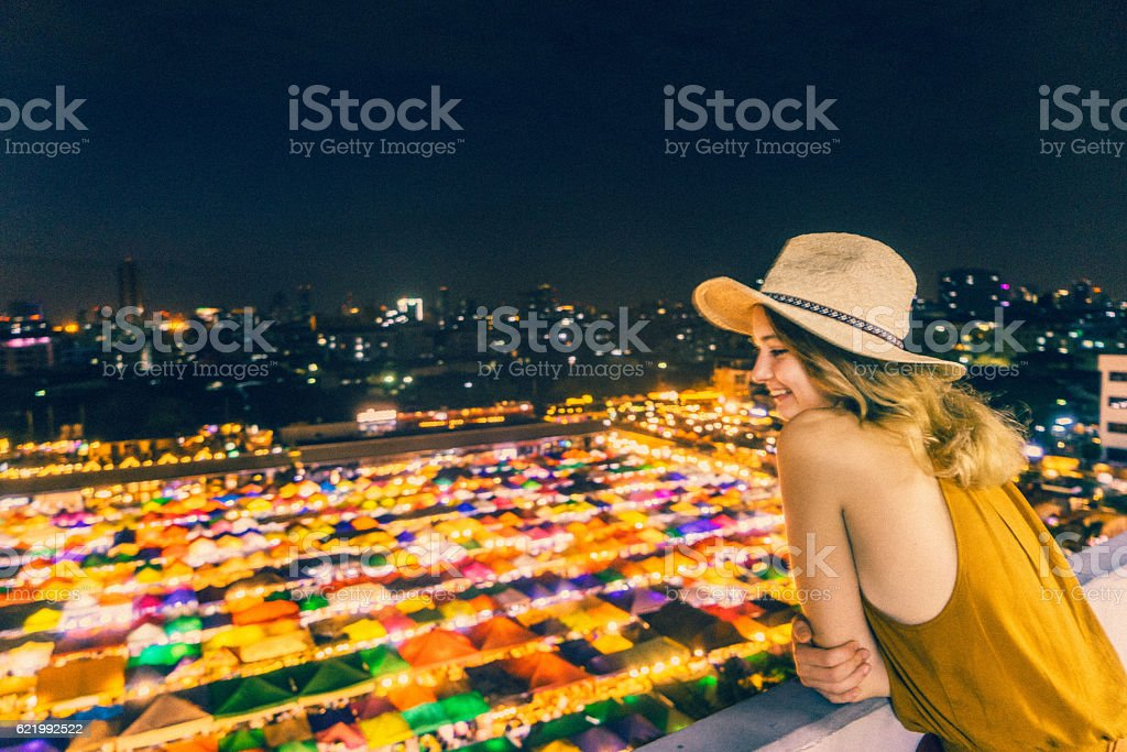 Woman looking at Train night market in Bangkok stock photo