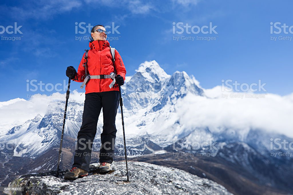 Woman looking at view, Mount Ama Dablam on background stock photo