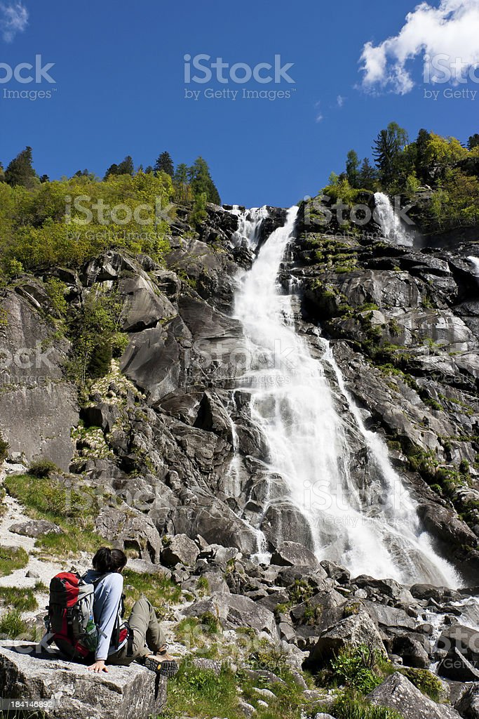 Woman looking at Waterfall in the Dolomites royalty-free stock photo