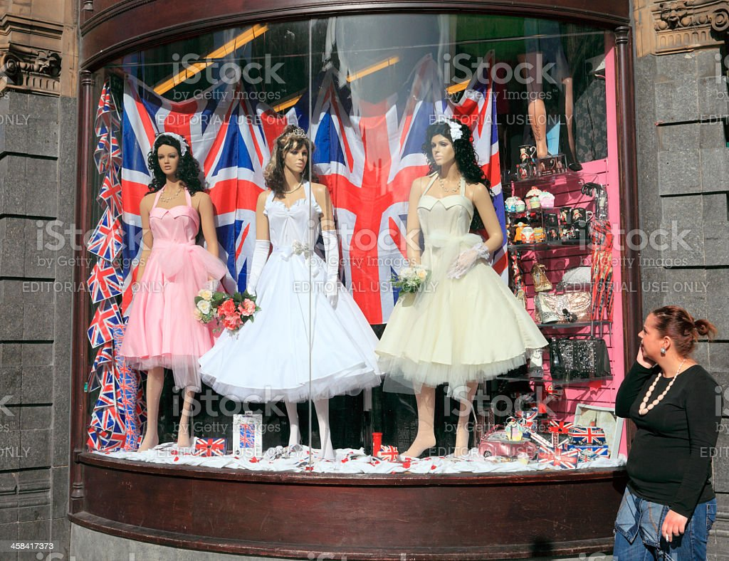 Woman looking at wedding window display stock photo