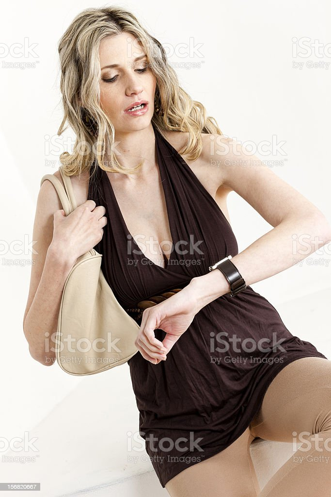 woman looking at wristwatch royalty-free stock photo