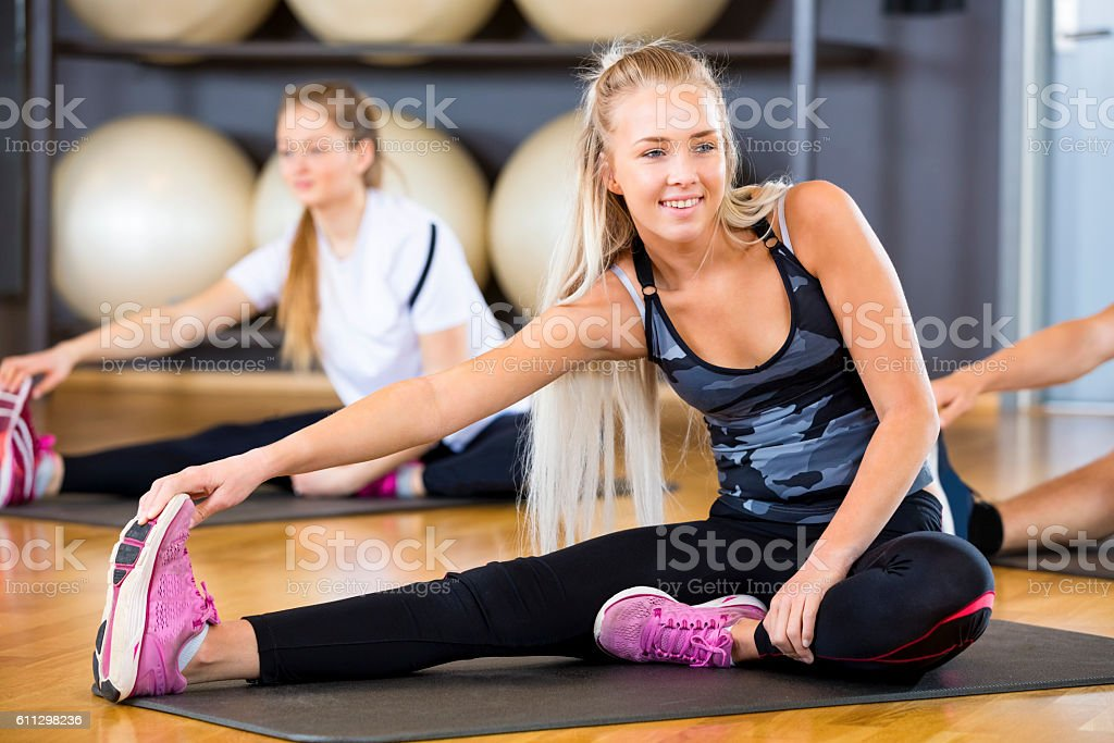 Woman Looking Away While doing Stretching Exercise stock photo