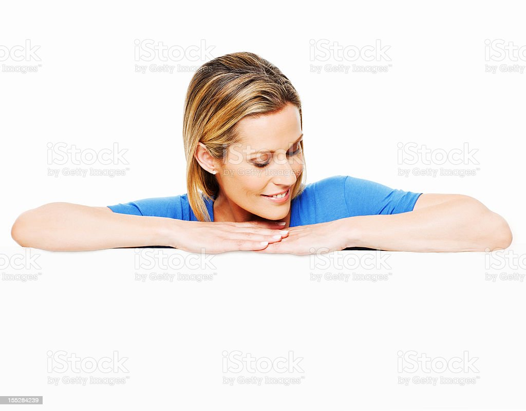 Woman Looking Down Over a Blank Sign royalty-free stock photo