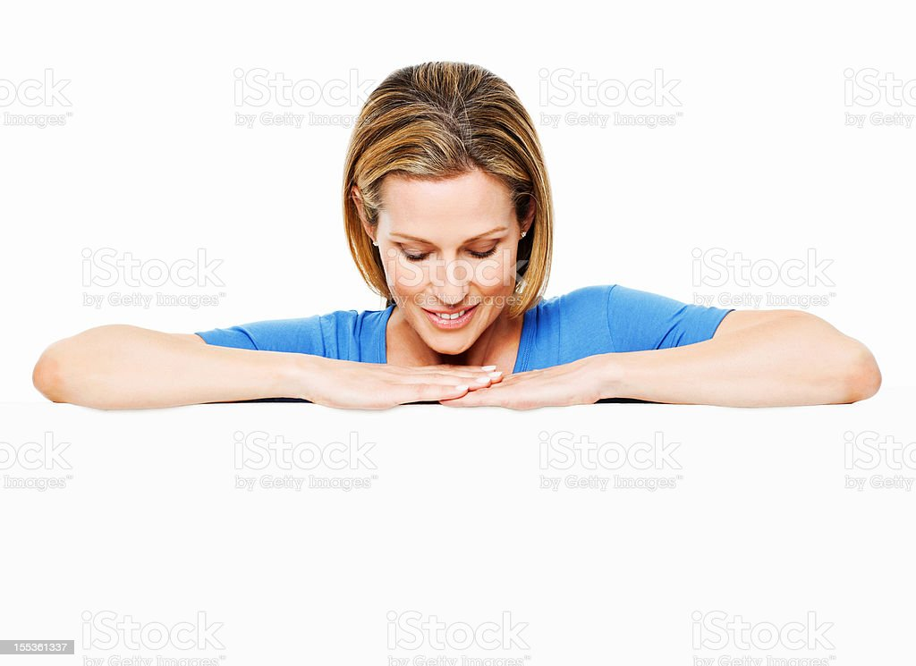 Woman Looking Down Over a Blank Wall - Isolated royalty-free stock photo
