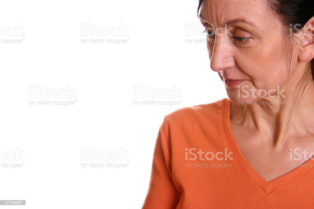 Woman looking down stock photo