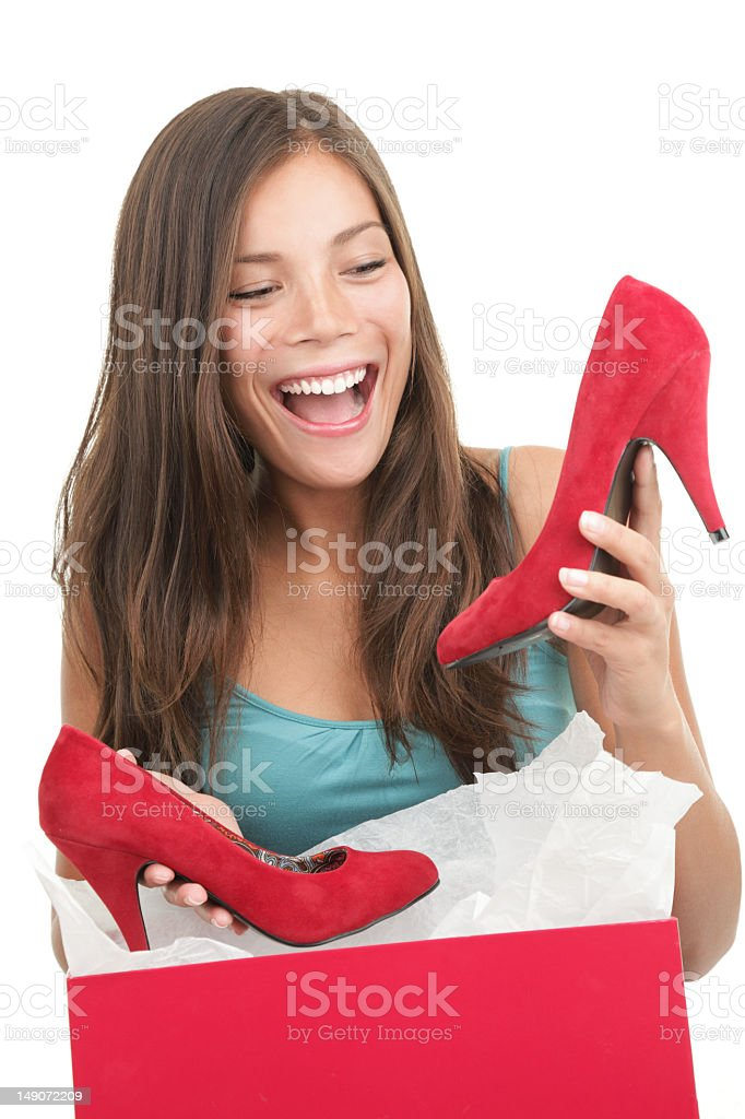 A woman looking excited at her red shoes royalty-free stock photo