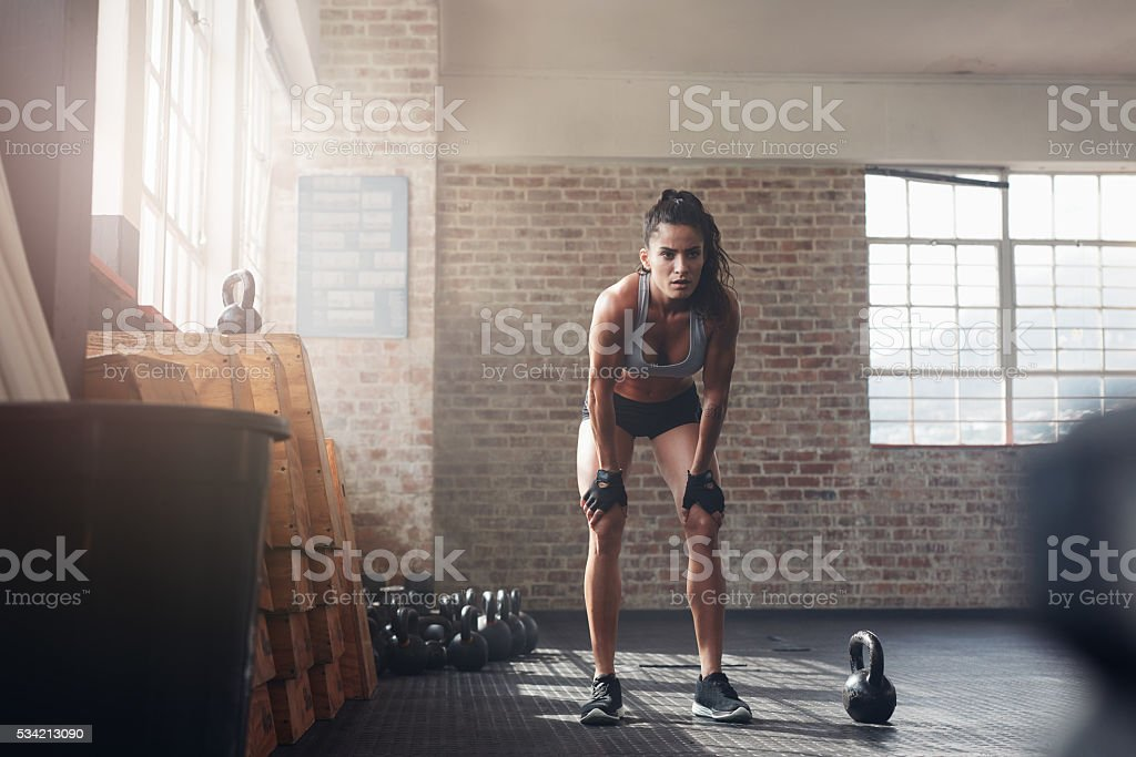 Woman looking focused about her fitness workout stock photo