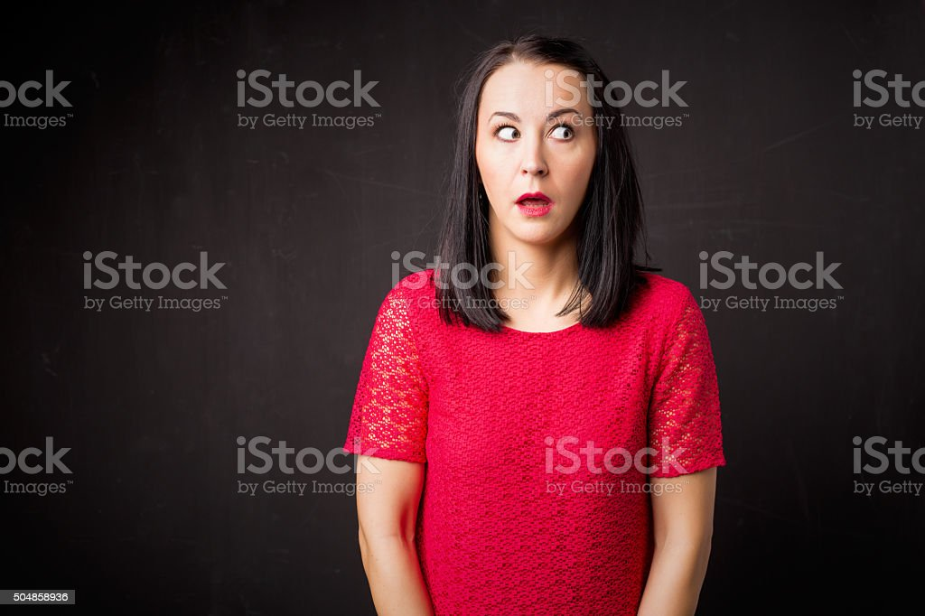 Woman looking guilty stock photo