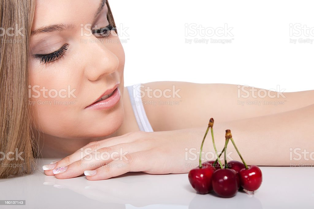 woman looking in cherries stock photo