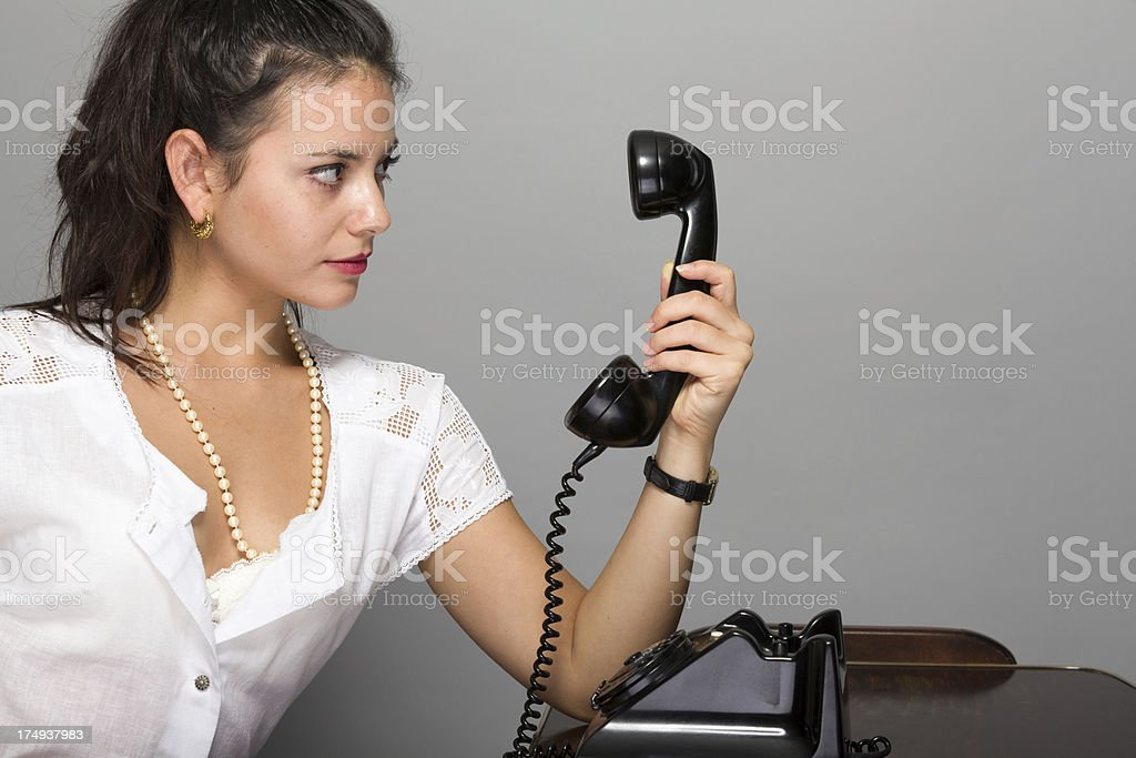Woman looking in  telephone stock photo
