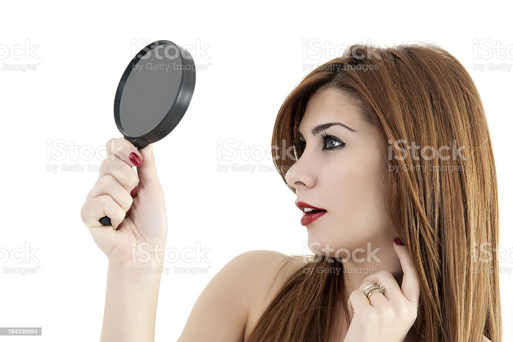Woman looking in the mirror royalty-free stock photo