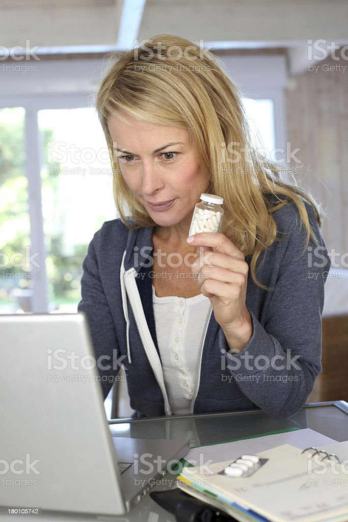Woman looking information about a new medicament stock photo