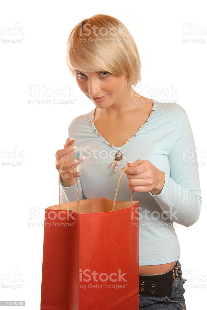 Woman looking inside the bag royalty-free stock photo