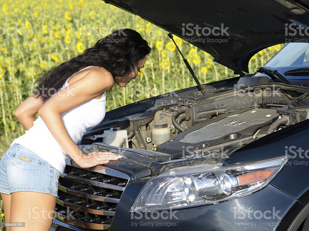 Woman looking into car engine royalty-free stock photo