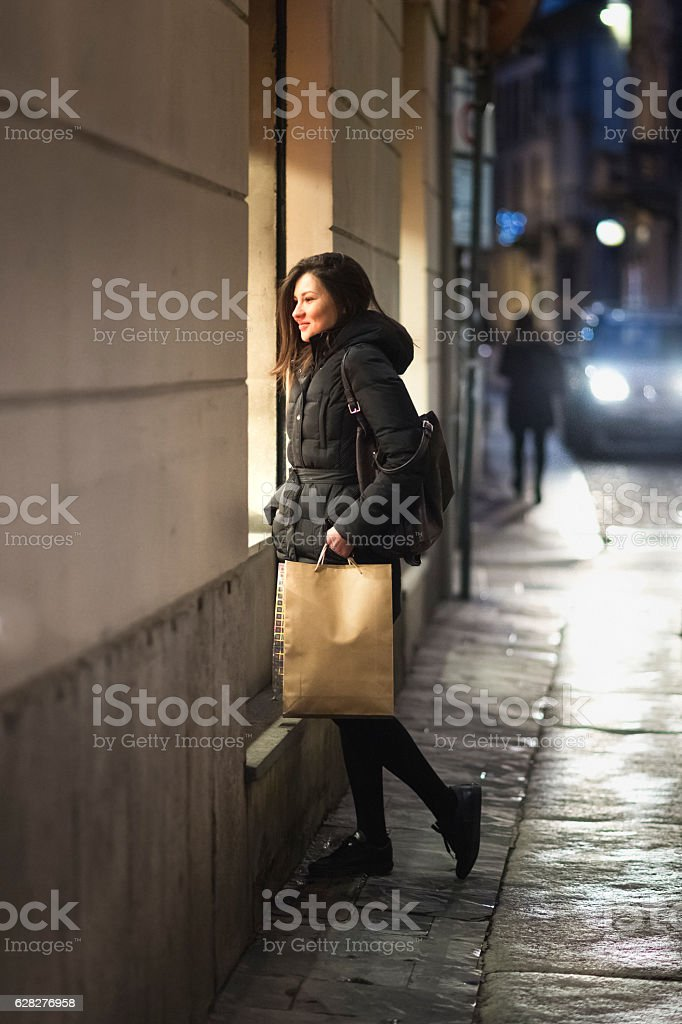 Woman looking into shopwindow. stock photo