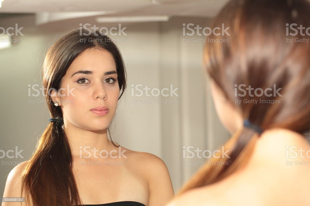 Woman Looking on Mirror stock photo