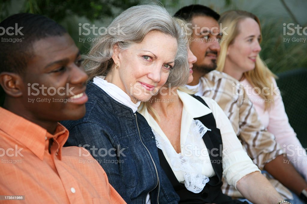 Woman Looking out from a crowd royalty-free stock photo