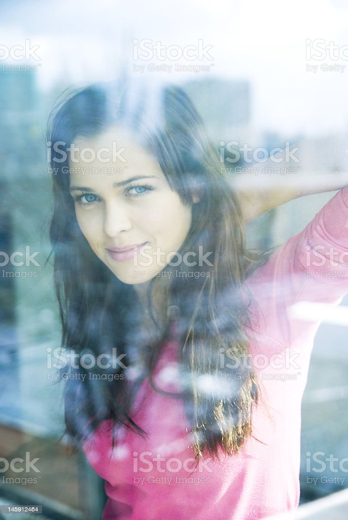 Woman looking out of window stock photo