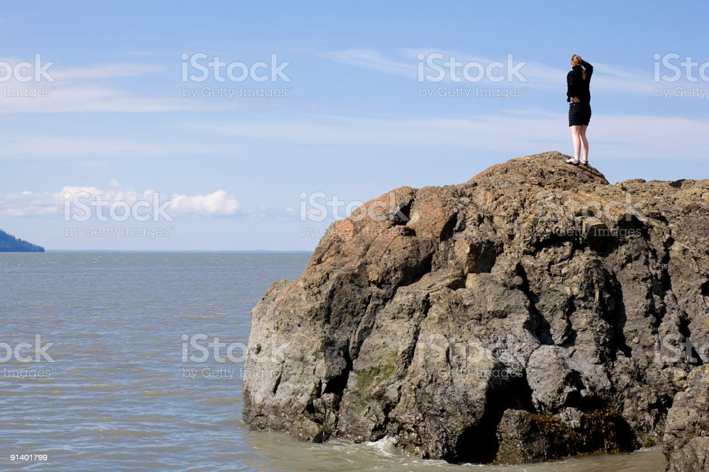 Woman Looking Out over Ocean stock photo