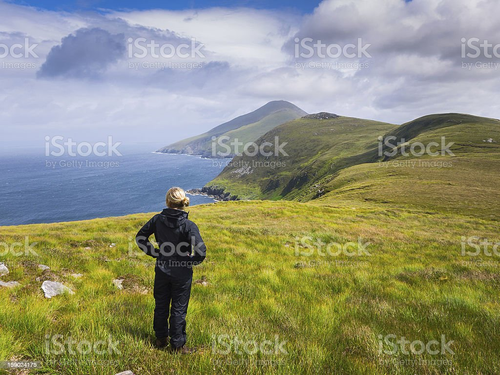 Woman looking out over sea stock photo