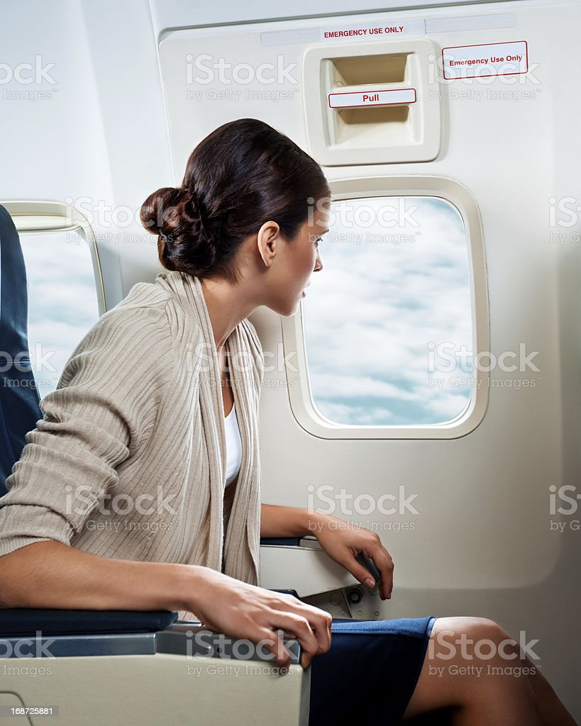 Woman looking out the window royalty-free stock photo