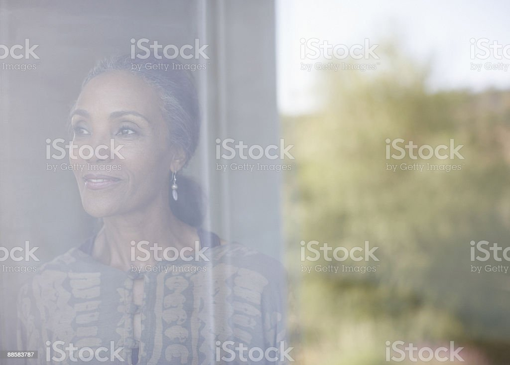 Woman looking out window royalty-free stock photo