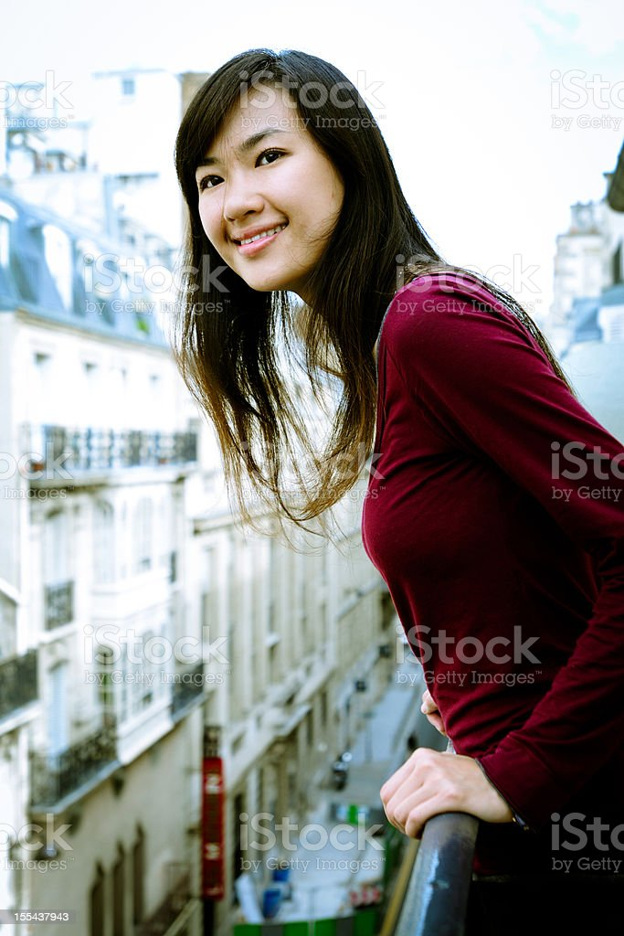 Woman Looking Outside From Balcony - XLarge stock photo