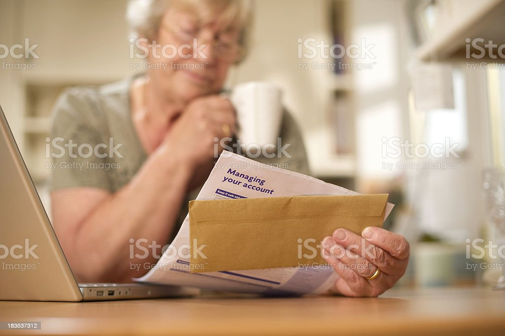 Woman Looking Over a Bank Statement royalty-free stock photo