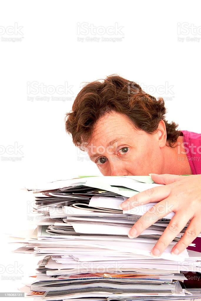 Woman looking over a stack of papers royalty-free stock photo