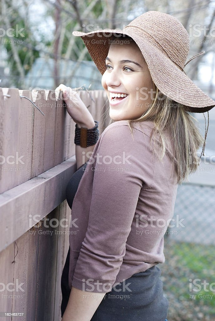 Woman looking over fence stock photo