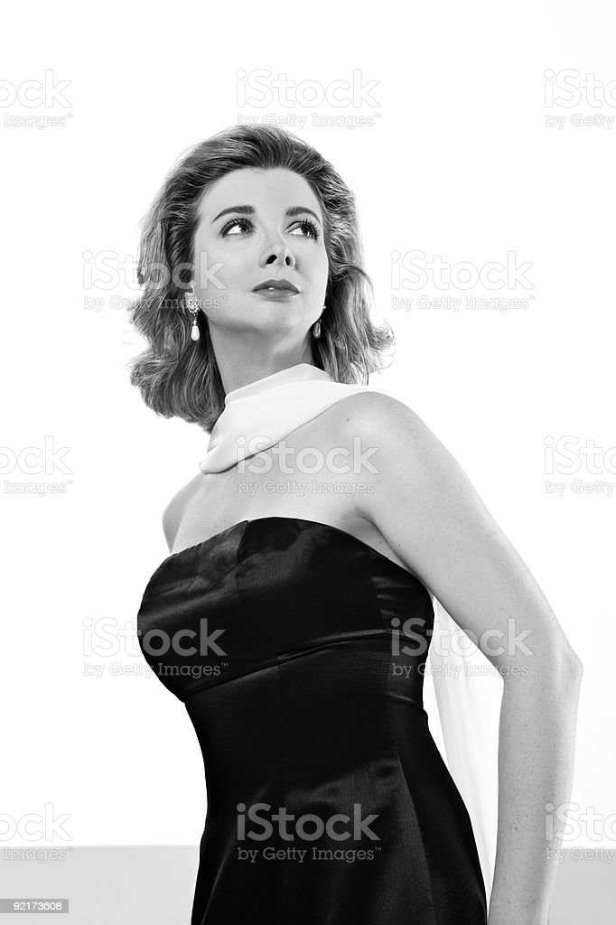 Woman looking over her shoulder black and white royalty-free stock photo