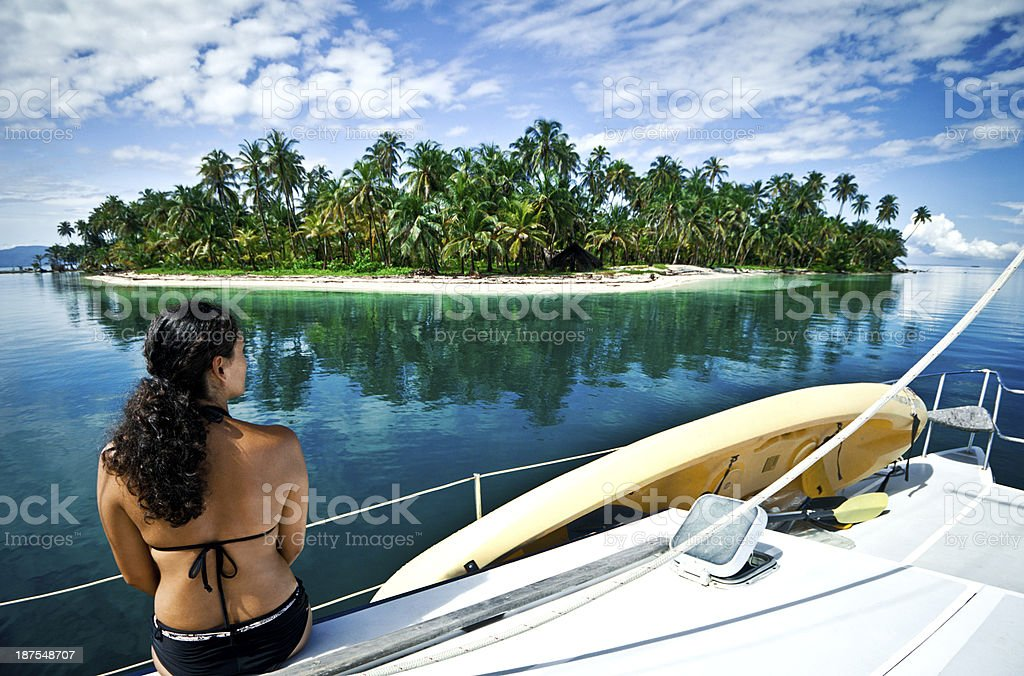 Woman looking over idyllic island stock photo