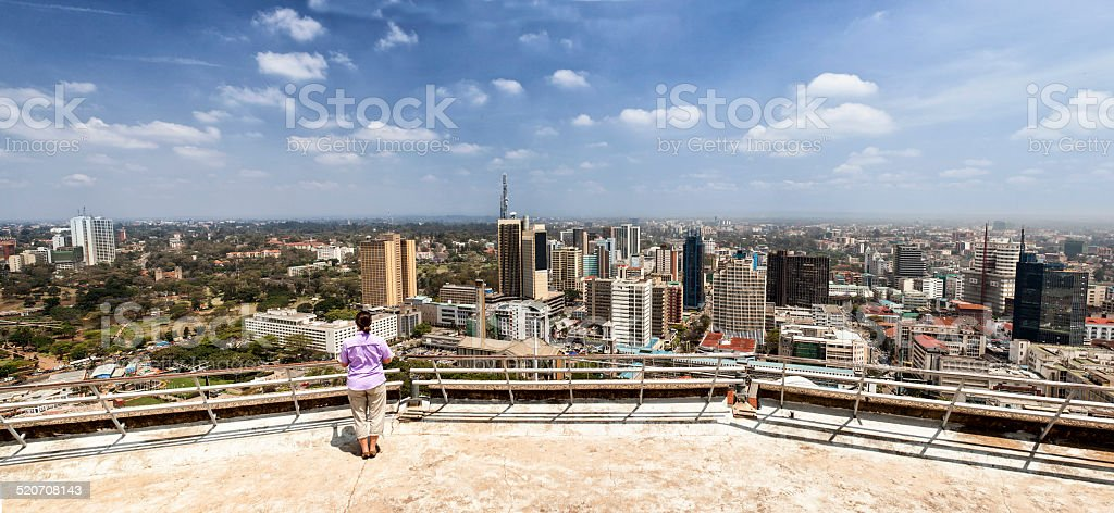 woman looking over Nairobi stock photo