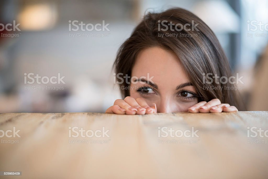 Woman looking over the table stock photo