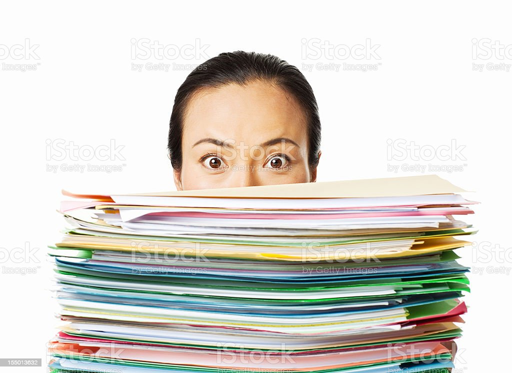 Woman Looking Over Work Files - Isolated royalty-free stock photo