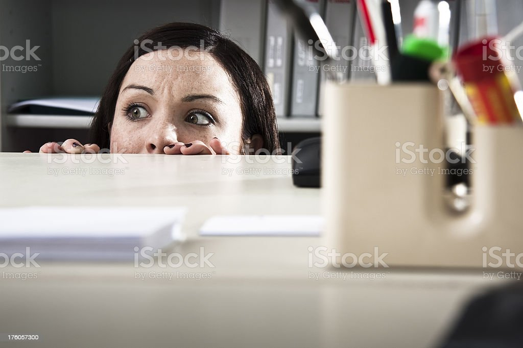 Woman looking scared in an office royalty-free stock photo