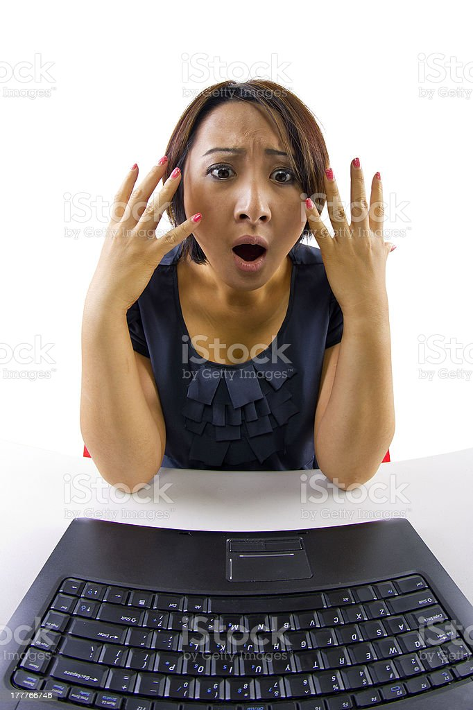 Woman looking shocked using a webcam royalty-free stock photo