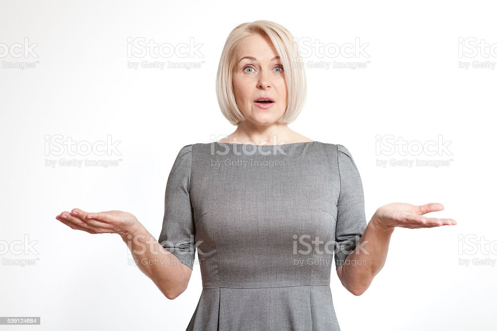 Woman looking surprised isolated on white background stock photo