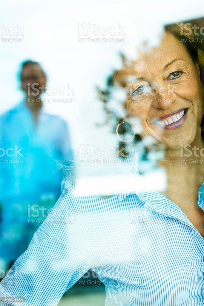 Woman looking through a window royalty-free stock photo