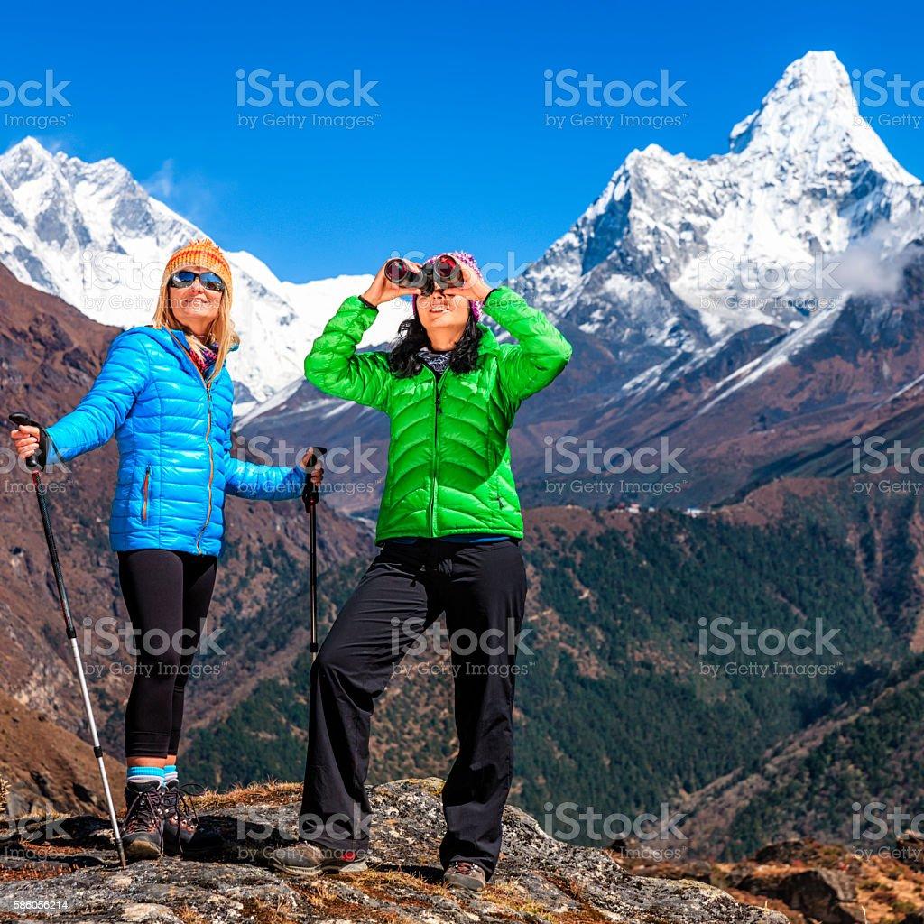 Woman looking through binoculars in Himalayas, Mount Everest Region stock photo