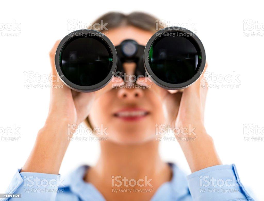 Woman looking through binoculars stock photo