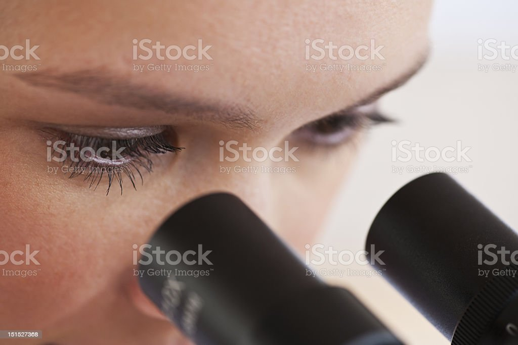 woman looking through microscope royalty-free stock photo